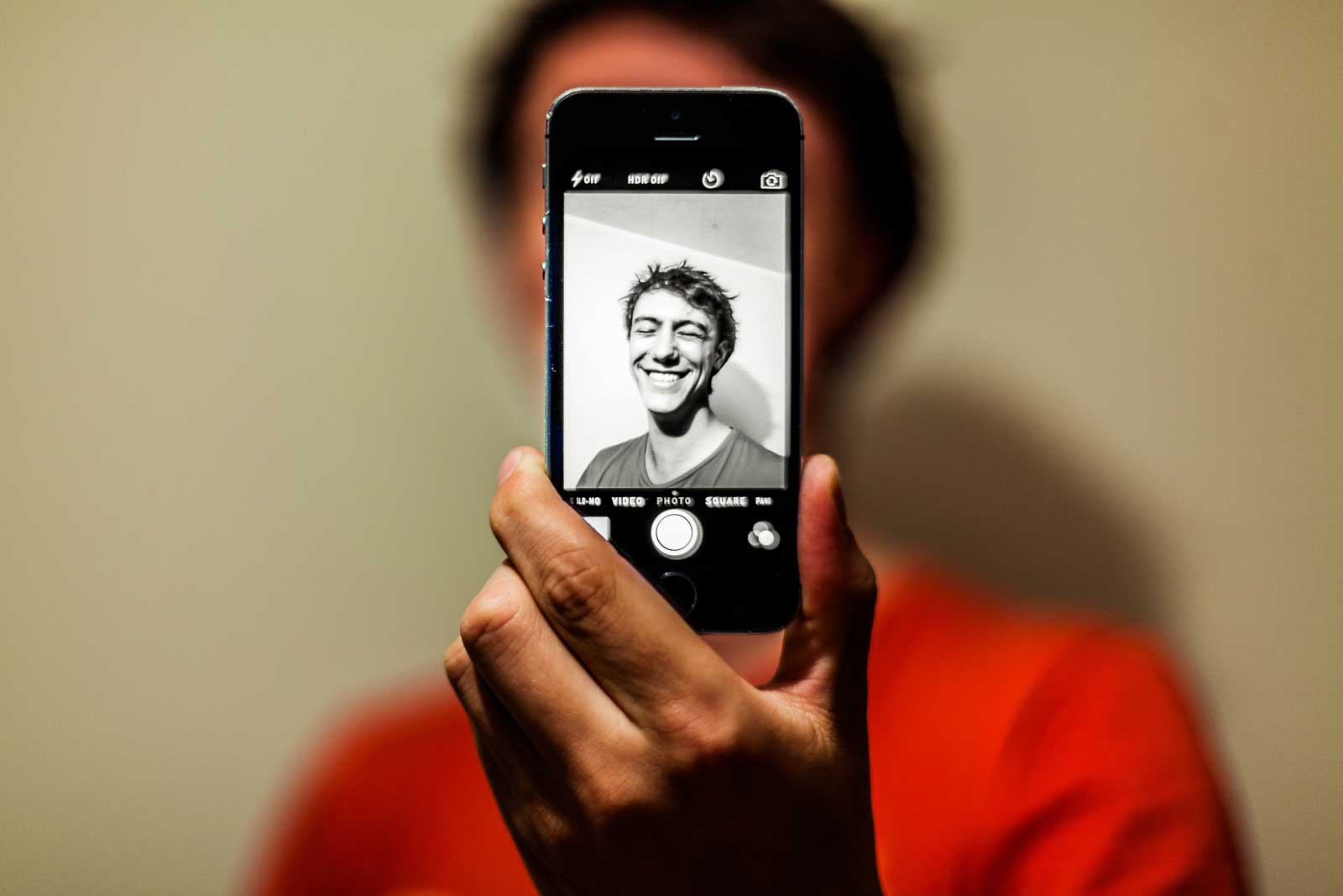 man smiling on phone